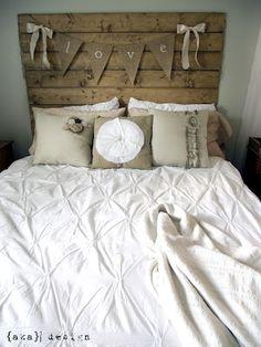pretty white bedding, wood headboard