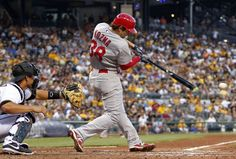 Pete Kozma hits an RBI single in the fourth inning against the Pittsburgh Pirates...Cards won the game 13-0.  8-01-13