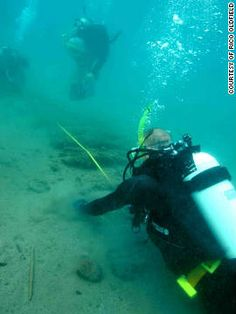Entrepreneur Pat Croce dives over the ribs of a ship believed to be part of the wreckage of 16th century ships Delight and Elizabeth. Croce and the diving team measure the shipwreck found off the coast of Panama.