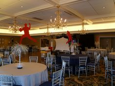 Baseball player centerpiece for sports theme Bar Mitzvah at Salem Waterfront Hotel, via Flickr.