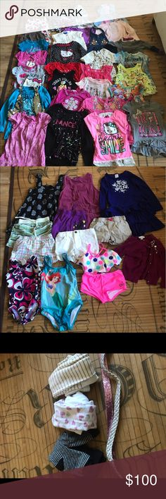 TONS of 4T & 5T girl clothes Tons of clothes in great condition! No holes or stains. 15 T-shirts 4 tank tops  10 long sleeves 8 shorts 3 dresses 3 swimsuits 3 tights 2 belts 2 hats 2 pillow pets  62 items total! My price is firm and would like to keep all items together. This is a great deal. Some items are new and don't have tags. Get it all before it goes into a garage sale may 20th Shirts & Tops
