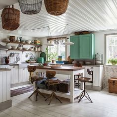 Love the baskets hanging, the chairs, pretty much everything!