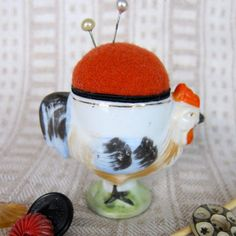 the fancier the egg cup, the cuter the pin cushion