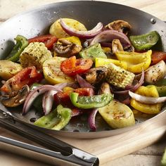 A tasty BBQ side. Toss peppers, corn, onions, squash and mushrooms in oil and garlic and herb seasoning, then place in a grill pan or thread onto skewers.