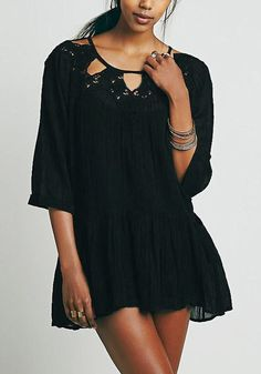 Lookbook Store // Embrace your unique free-spirited style by donning this black drop-waist peasant dress. It's designed with lace cutout around neckline, a half sleeves and front pockets.
