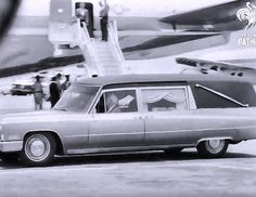 June 6, 1968: A hearse bearing Robert Kennedy's casket heads towards Air Force Two, at Los Angeles Airport.