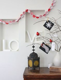 Love the red and white garland - by The Happy Home Blog