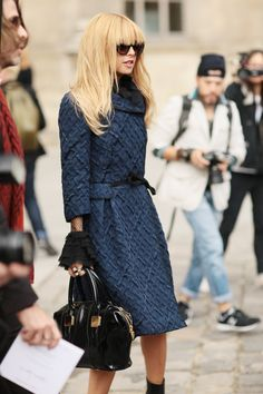 Rachel Zoe chic in a textured navy coat and dramatic ladylike sleeves peeking out from underneath #StreetStyle