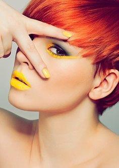 Vermillion orange hair with yellow lips and long yellow streak under eye.