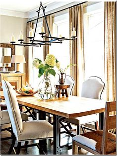 Dining room with burlap panels- since burlap is so inexpensive, use three widths instead of one for a fuller look.  Curtains in Cote De Texas Blog Aug 2009  http://cotedetexas.blogspot.com/2009/08/top-ten-design-elements-4.html