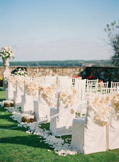 The dreamiest #ceremony setup #chaircovers #petals Photography: ktmerry.com | Planning: lafleurweddings.com | Florals: botanicaflorist.com
