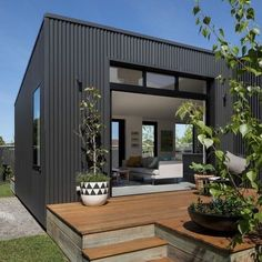 from // COLORBOND(r) steel perfection 🖤 designed by 📷 via image via Exterior Wall Cladding, House Cladding, Steel Cladding, Backyard Cottage, Garden Cottage, Black House Exterior, Casas Containers, Bungalow Renovation, Shed Homes