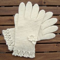 White Gloves With a Flower And Lace-Edging - free crochet pattern by Jolanta Gustafsson. There are more patterns for hands here.