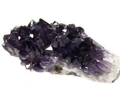 Vibrant purple Amethyst Cluster can be displayed lengthwise or upright. Shop our highest quality Amethyst Crystals and Clusters at an affordable cost.