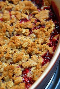 Easy strawberry-rhubarb crisp recipe. Add: juice and zest of half a lemon and 1/2 T corn starch to filling plus 1/2 cup extra oats to topping.