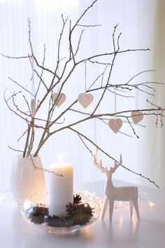 White ceramic and bare branches make for simple and modern Christmas decor | Christmas Style | Nordic
