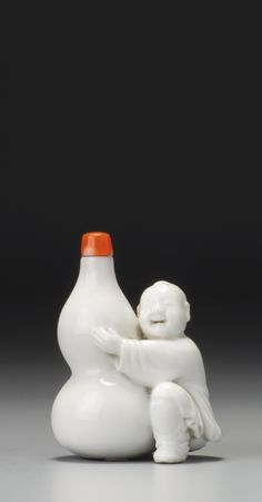 A moulded white porcelain 'boy and double-gourd' snuff bottle, Qing dynasty, 18th-19th century