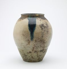 Shigaraki ware wide-mouthed jar  19th century      Edo period or Meiji era     Stoneware with white, copper-green, and manganese-purple lead-silicate glazes; gold lacquer repairs  H: 38.5 W: 32.3 cm   Shigaraki, Japan