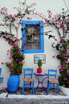 Cafe set and bougainvillea on the Greek islands
