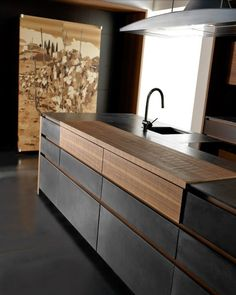 Инновационный дизайн TONCELLI CUCINE завораживает, открывая новые грани минимализма... Дерево, бетон, кожа и итальянская страсть к достижению совершенной красоты - это неудержимый микс роскоши, силы и чувственности, который поднимет тебя на новый уровень понимания жизни, доступный далеко не каждому.