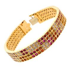 H & D Diamonds is your direct contact to diamond trade suppliers, a Bond Street jeweller and a team of designers.www.handddiamonds...Tel: 0845 600 5557 - Cartier Lanieres Multicolor Fancy Sapphire Diamond Yellow Gold Bracelet