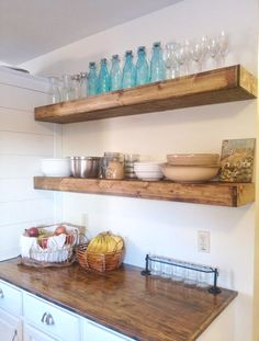 Floating shelves above the table.