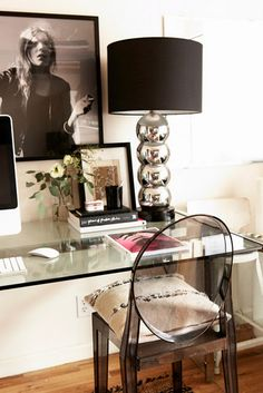 Modern office with a glass desk and bold decor