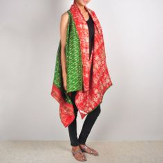 Green-Red Kantha Shrug Kantha sari shrugs are a unique variation on our sari shawls. Loose-fitting and free-size, they can be worn in a dozen ways and are an elegant, reversible and hands-free way of wearing our beautiful kantha fabric. Wear them loose; wear them wrapped around your body and tied with a brooch; wear them fastened with a belt. Shop no at: http://www.tadpolestore.com/house-of-wandering-silk #silk #shrug #newdesigndaily #designgoodness #designer #kantha #unique
