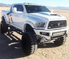 White Dodge Cummings 4th Gen. definitely stands out with the white and black combo #Dodge #Cummins #Lifted