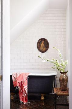 Full tile wall in the bathroom + cast iron clawfoot tub + brass legs on the bathtub + vintage portrait + stool by the tub + vintage bathroom Beautiful Bathrooms, Modern Bathroom, Small Bathroom, Modern Toilet, Bathroom Beach, Minimal Bathroom, Bathroom Bin, White Bathrooms, Brown Bathroom