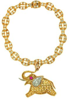 Vintage Van Cleef and Arpels gold and diamond elephant charm bracelet. Via Diamonds in the Library.