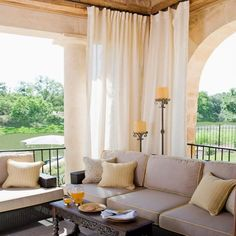 Adding curtains to a patio not only adds privacy, it's also a way to cool down a patio during the hot summer months with lightweight, airy fabrics - or swap out curtains with a heavier fabric during the cooler months to add warmth and be able to spend more time outdoors