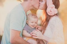 I think another key to nice pictures of parents with newborn or infant is to wear softer colors!! *jess*