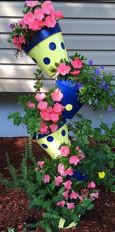 Flower Tower Planter Clay Pot Tower Polka dot Planters   Garden Decor Yard Decoration UNIQUE GIFT by GARDENFRIENDSNJ on Etsy https://www.etsy.com/listing/523890265/flower-tower-planter-clay-pot-tower