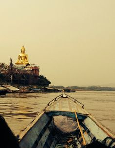 Traveling by long boat up the Mekong River, Thailand