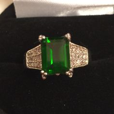 BUYERS DREAM Rare Russian Chrome Diopside  EXCEPTIONAL VALUE THIS SIZE IS CONSIDERED LARGE & VERY RARE. YAY. Mined only 3. Months out of the year Source is from Siberia.. Only Discovered in early 1980's  . It is an opportunity of a lifetime to own pieces like this. One source gems are highly valued & very difficult to reach. Butterflies on each side,along with Rare Silver Zircon Gemstones. Treasure.over 1 carat ..   PHOTO ENLARGEDNO DISCOUNTS Gemstones from Russia Jewelry Rings