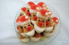 Santa cookies:  nutter butter cookies,  Melted white chocolate,  red sugar,  mini chocolate chips & red hot candies or red m