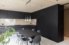 Asymmetrical Pitched Roof Defining Minimalist Family Home near Munich. Black walls!