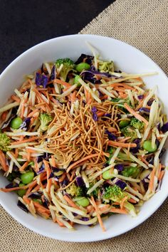 Asian Slaw with Ginger Peanut Dressing - this one uses convenient pre-cut broccoli slaw and tops it with a peanut butter and ginger dressing. Asian Broccoli Slaw with Ginger Peanut Dressing Rachel @ Craving Some Creativity CravingSomeCreativity Foo Brocolli Slaw, Asian Broccoli Slaw, Asian Slaw, Asian Coleslaw, Broccoli Slaw Dressing, Broccoli Slaw Salad, Broccoli Slaw Recipes, Edamame, Vegetarian Recipes