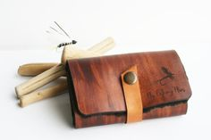 This handmade fly fishing flies pouch is made of genuine leather and shearling wool to be easy to put and take the flies from the wallet.  Personalizable with name address ... #craftiveleather