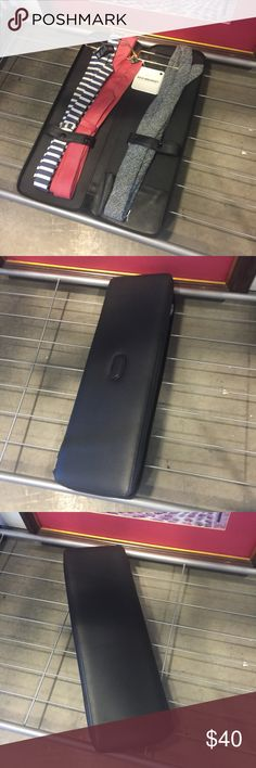 "Men's Black Leather Business Travel Tie Case Actual case in my men's accessories store in Las Vegas. Store pickup available.  Preowned in excellent condition Zip around closure Genuine leather Keeps ties neat and flat Holds up to 4 classic-size ties Gold-tone hanger Ties not included 17""H x 6""W x 1""D Imported Unbranded Bags Luggage & Travel Bags"