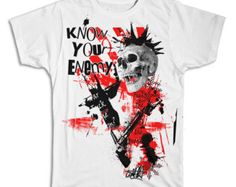 Enemy Skull collage t-shirt printed on comfortable ringspun cotton t-shirt.  Skull design is perfect for skate and streetwear.