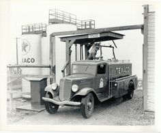 Texaco bulk truck being with fuel for home delivery.