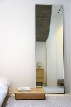 Chic studio apartments with artsy accents bedroom for Tall bedroom mirror