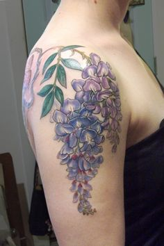 Beautiful wisteria tattoo by Esther Garcia.