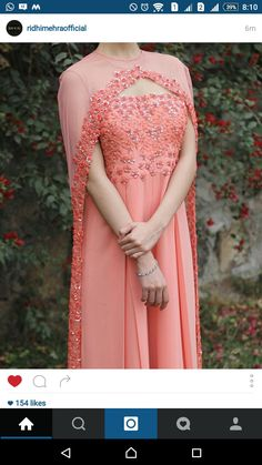 The Stylish And Elegant Gown In Peach Colour Looks Stunning And Gorgeous With Trendy And Fashionable Fabric Looks Extremely Attractive And Can Add Charm To Any Occasion. Shrug For Dresses, Indian Gowns Dresses, Pakistani Dresses, Dress Up, Cape Dress, Pakistani Suits, Pakistani Bridal, Dresses Dresses, Indian Bridal