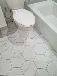 Add an elegant appeal to your living space by selecting this Toscana Carrara Hexagon Matte Glazed Porcelain Floor and Wall Tile. Hexagon Tile Bathroom, Carrara Marble Bathroom, Porcelain Floor, Hexagon Floor Tile, Vinyl Hardwood Flooring, Wood Tile Floors, Bathroom Flooring, Parquet Flooring