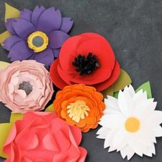 Get ready for one of the most jam-packed paper punch flower tutorials you've ever seen! This Paper Punch Flower Garden is the perfect project for Mother's Day. Make your own pretty paper flowers, including peonies, zinnias, daisies, and more.