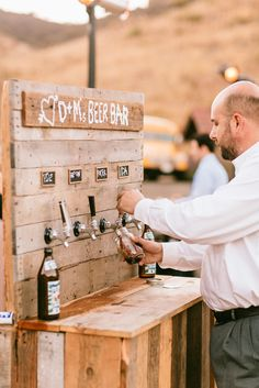 This is so awesome! aDIY beer bar for a wedding.  @Mary Powers Powers Kate Huebener you need this for your wedding!!!!