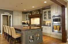 white and brown and gray cabinets